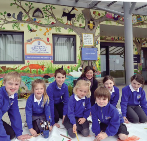 Pictured in front of Cleddau Reach's new mural are pupils Zachary, Scarlett, James, Imogen, Rowan, Katie and Roxy, with Fran Evans.