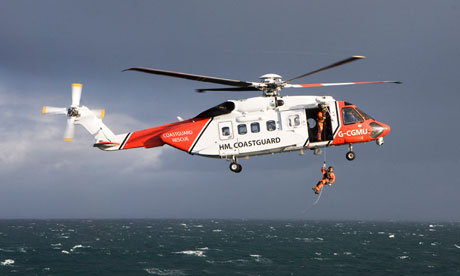 Coastguard helicopter in search for missing crew member