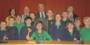 Councillor Wynne Evans: flanked by the children of St Dogmaels School on their visit to County Hall. Also pictured is Councillor Mike James, Mrs Ann Caygill, a Governor at the School and Helen Evans, from Pembrokeshire Archives
