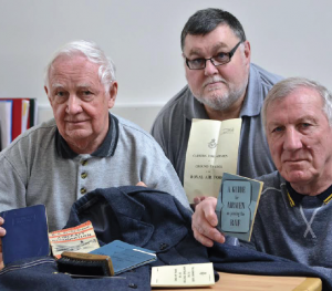 Doug Fulcher (left) and David Freeman with some of the documents donated to the Heritage Centre. With them is Sunderland Trust Volunteer Barry Clark who, with his wife Margaret, made a video recording of both former airmen for the Heritage Centre's oral history project.