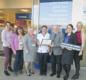 (L to R): Claire Billingsley, Young Carer Worker; Julie Campbell, Investors in Carers Officer; Sian-Marie James, Hywel Dda; Claire Setford, Carers Lead for Boots; Cllr Mike James P CC Carer Champion; Stephanie James, Store Manager, and Rebecca Thomas, new Store Manager