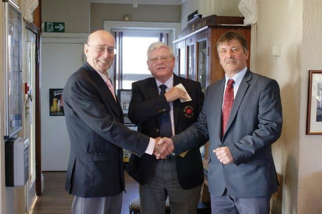 Rotary President Frank Courie: Presents the donation to Milford Golf Club President Steve Brown and Club Captain Jeff Button