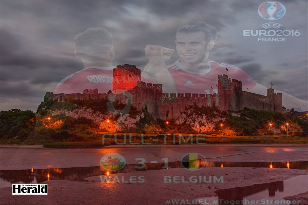 Pembroke Castle lit up red to support Wales (Pic: M Hillen/Herald)