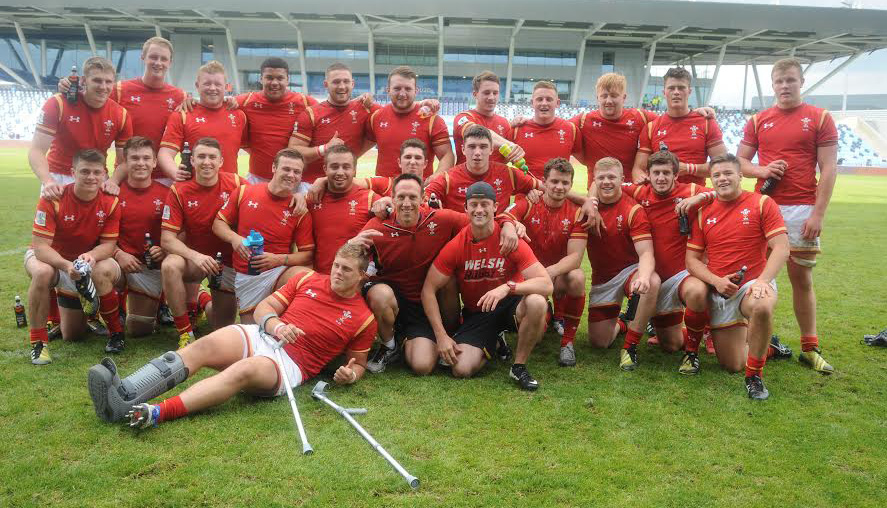 Stepping down: Mark Taylor with the U20 squad after their win over Scotland