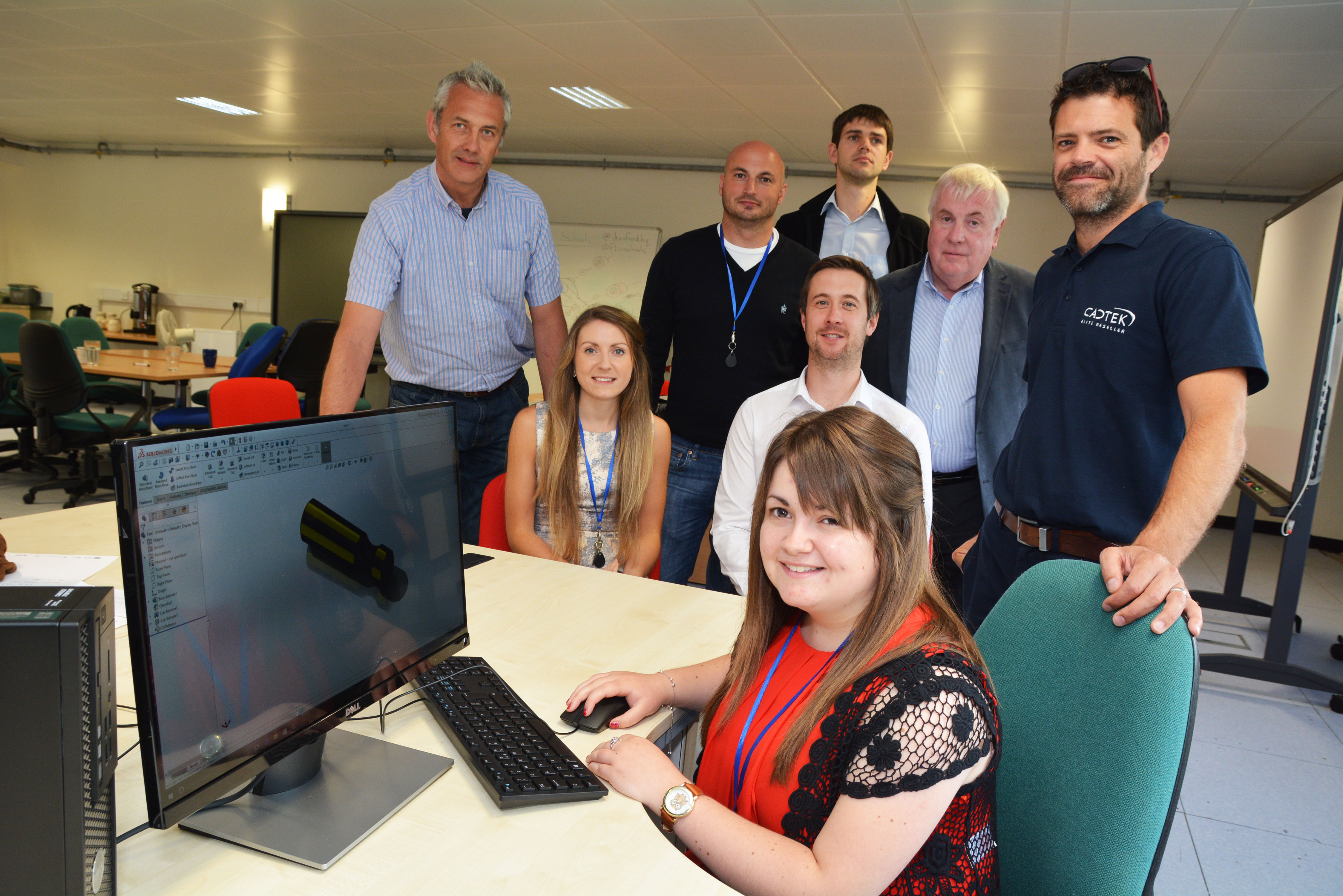 Pictured are (left to right, standing) Dave Thomas BIC Manager, Nik Curcio of Pembrokeshire Design, Thomas Wheeler of Insite, Cllr Keith Lewis, Jamie Thain of CADTEK, (sitting) Annabelle McLaren of Insite, Gethin Davies of CADTEK, Ellie Wheeler of Insite.