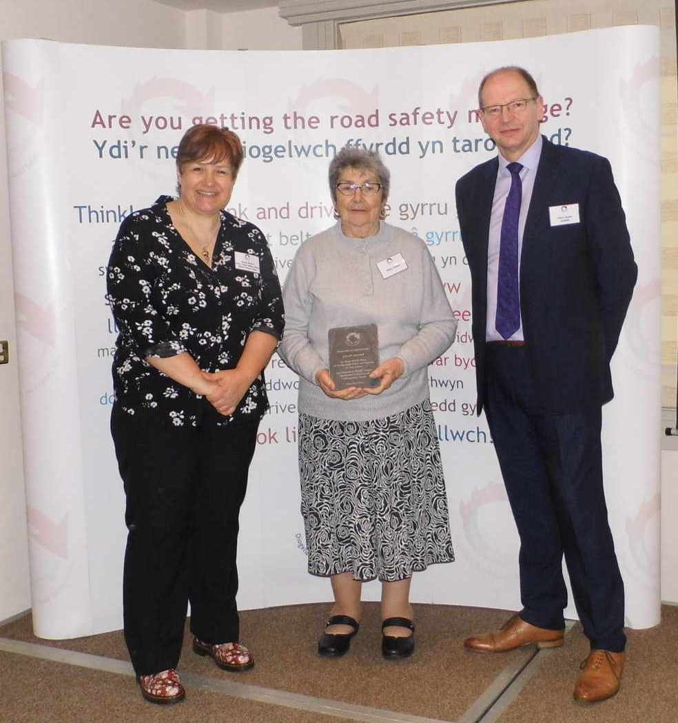 Pictured is Daisy Lambe receiving her Road Safety Wales Award from Sue Storch, Chair of Road Safety Wales, and Chris Hume from Go Safe (and Deputy Chair of Road Safety Wales).