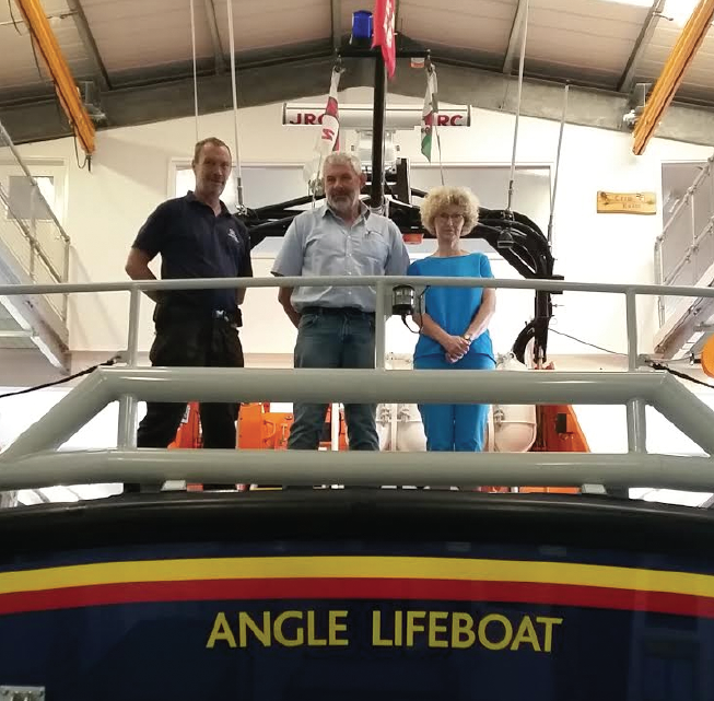 (L-R): Rich Bowles, Angle Lifeboat Station Mechanic, Training Officer and Crew member, with Peter Kidney and Jane Kidney
