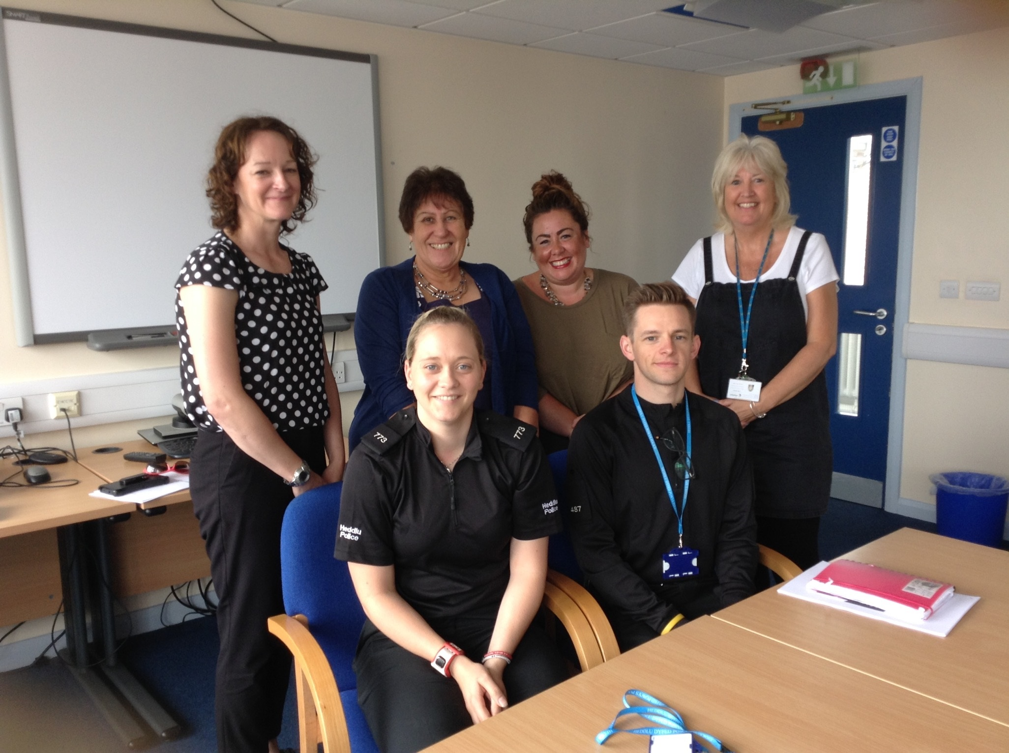 Domestic abuse training: Jenny and her colleagues are pictured with student officers Zoe and Kyle.
