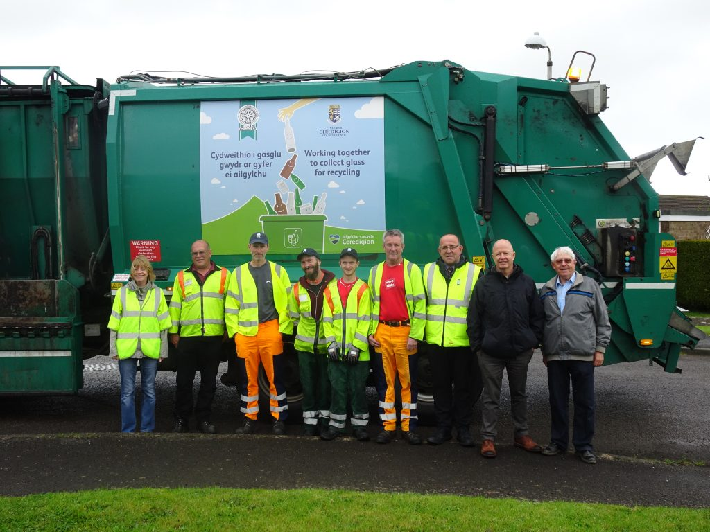 Pictured are (left to right): Beverley Hodgett Waste Strategy Manager CCC, Jonathan Merrett Municipal Superintendent CCC, Andy Sear Waste Collection Crew PCC, Scott Reeve Waste Collection Crew CCC, Wyn Davies Waste Collection Crew CCC, Micky McQuillan Waste Collection Crew PCC, Peter Harts Waste Operations Manager PCC, Councillor Alun Williams and Councillor John Adams Lewis.