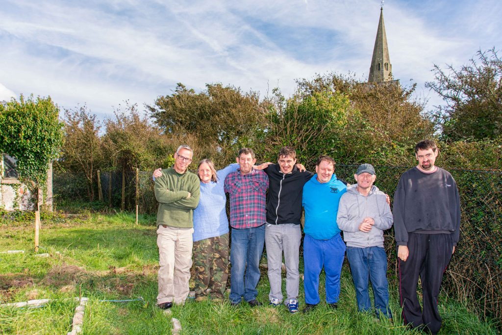 The plot for the polytunnel left to right Paul Cook, Marion, Anthony, Tommy (knuckles), Jason, John and Robert (pic. Mike Hillen)