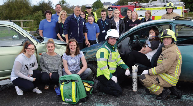 Councillor Rob Lewis and youth worker Nick Hudd, together with members of the emergency services: With the young drivers that attended the workshop