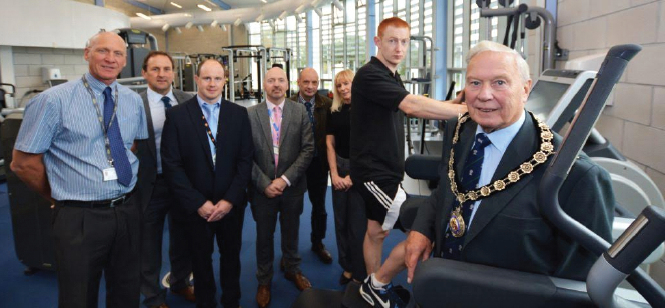 Pictured at the launch (L-R): Chris Payne, Leisure Services Manager; Councillor Elwyn Morse, Cabinet Member for Culture, Sport and Leisure; Darren Bowen; Councillor Hancock; Ian Westley, Council Chief Executive; Julie Ashley-Jones, Principal Leisure Development Officer; Fitness Instructor Tom Delaney and Cllr Brinsden