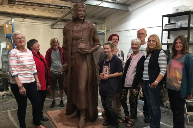 Fundraising group: With a clay mould of the statue.