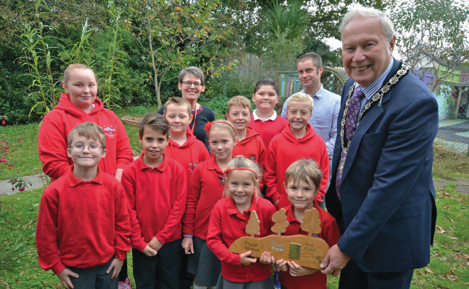 Cllr Brinsden and Stepaside pupils with the Acorn Sustainable Schools Award: With school secretary Theresa Williams and Sustainable Schools Officer Tim Brew