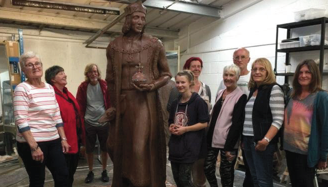 Fundraising group: With a clay mould of the statue
