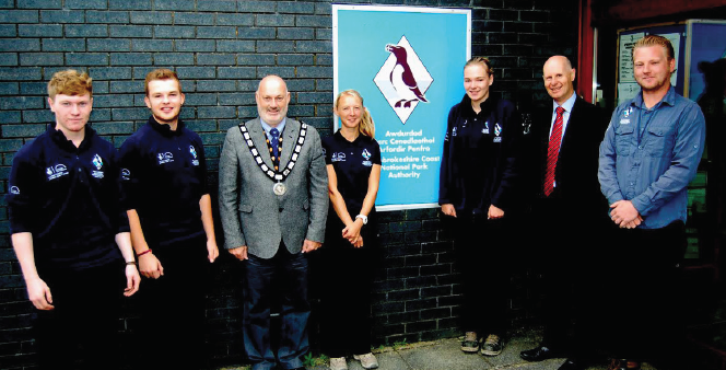 Pembrokeshire Coast National Park Authority's Skills in Action trainees: With Authority Chairman Cllr Mike James and Chief Executive Tegryn Jones
