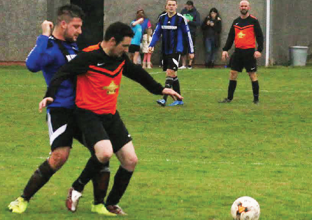 Battle: A Johnston player shields the ball from a Hakin player