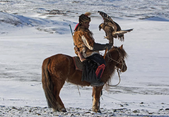 A great migration: A Kazak and their prized Golden Eagle (Pic. Jenny Hibbert)