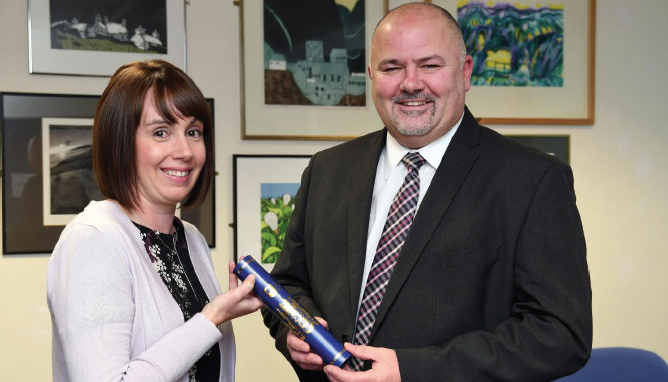 Top of the class: Sarah Handley and Jonathan Griffiths, Director of Social Services and Leisure