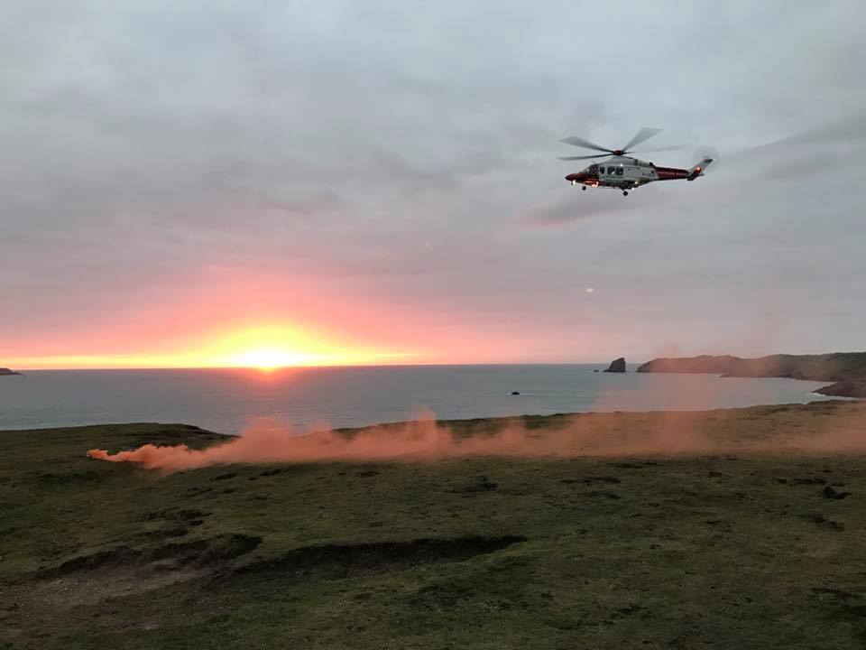 Rescue underway: Chopper 187 at Martins Haven to assist stranded walker (Pic D Jones)
