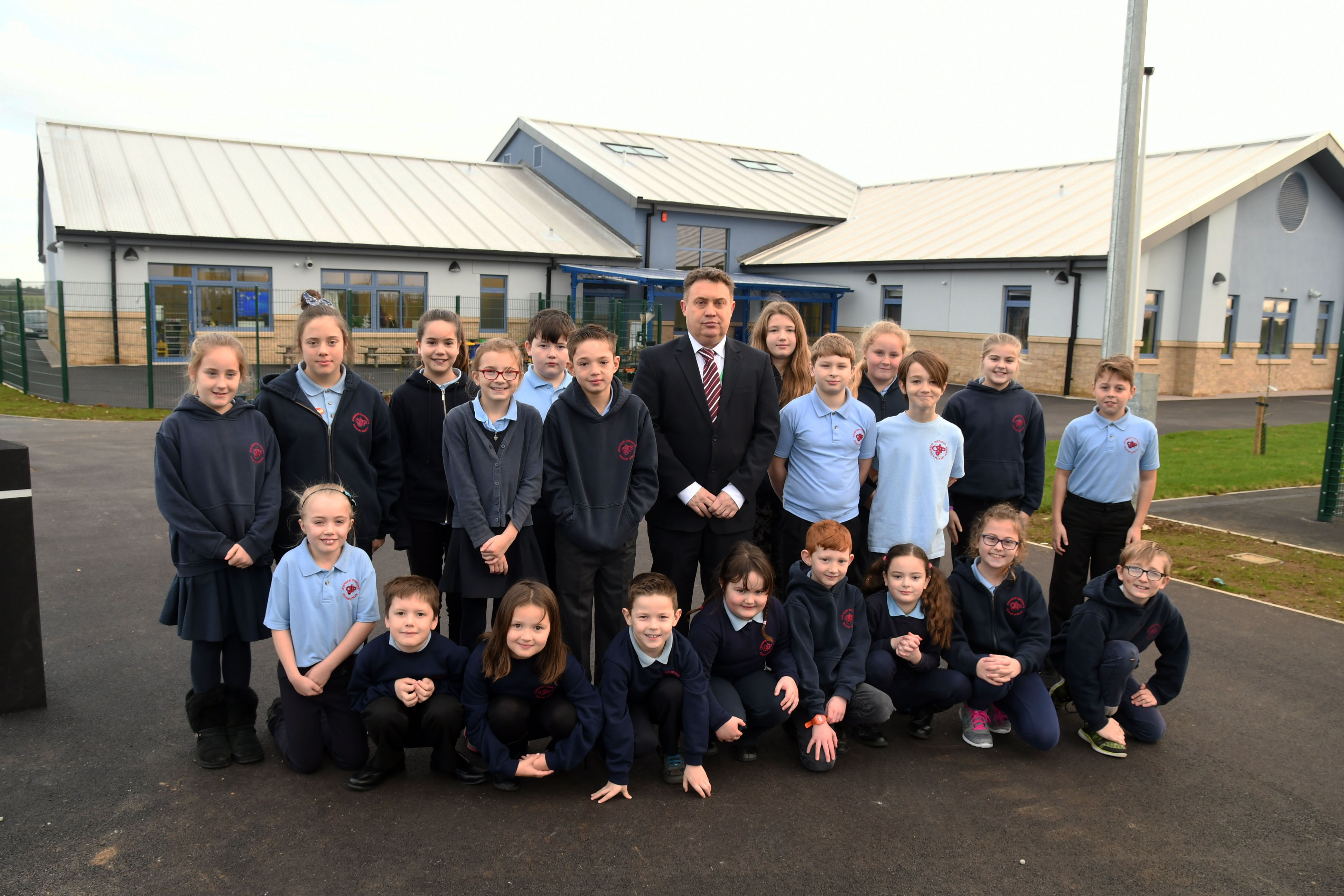 Headteacher Mr Gareth Thomas: Outside the new Johnston CP School with all members of the School Council.
